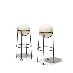 Pair of stools in blackened iron with Yo-Yo feet and soccerball seatby Jean Royère(1902-1984), c.1948. www.gallerybac.com