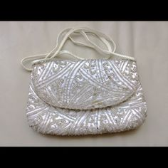 Vintage Theatre small clutch bag white embellished Small beaded bag, clutch , in good used condition , a few beads missing  in the back . It is made of satin , long shoulder strap can fit inside if you want to use it as a small hand held clutch bag . boutique Bags Clutches & Wristlets