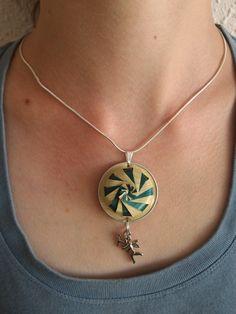 Round handmade eco-friendly pendant made from par ItemsForJane