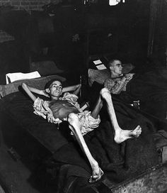 This is Private Joe Demler of the US Army, he was a guest of the Third Reich for barely 3 months before being liberated in April 1945. Dressed in his pajamas with his sleeves and pant legs rolled up he was photographed looking more like a skeleton wearing skin than a human being.