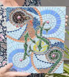 Kiwi and koru mosaic mural for Nick and Sarah also with their own logo, glass tiles, crystal tiles, mirror tiles, glass beads and ball chain on exterior treated ply.