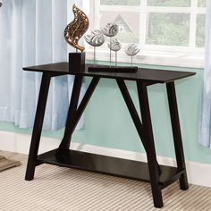 Make a style statement in your hallway or living room with this solid wood sofa table. This elegant table is the perfect place to set your keys or display a special photo frame, and it comes with either a sleek black finish or a classic white finish.