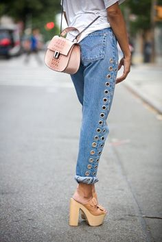 Spice up your denim with grommet detailing.