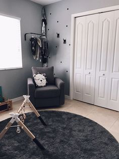 We spy a sweet little hanging rack in the corner of this nursery and we LOVE it.