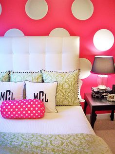 Sick of staring at boring white walls? Paint a bedroom wall a bold color and then add polka dots over it made out of contact paper. Easy DIY bedroom project.