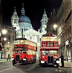 Vintage London buses with St. Paul's in the background.