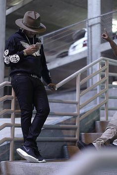 Future wearing  Fan Merchandise Freebandz Eagle Hoodie, Dior Logo Belt , Nike Roshe Run Winter Mesh and Suede Sneakers