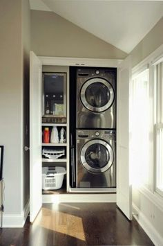 stackable laundry mudroom | Small Space Living Ideas to Create More SpaceDecorated Life Hidden Laundry, Laundry Closet, Small Laundry Rooms, Laundry Room Storage, Laundry Room Design, Laundry In Bathroom, Laundry Area, Laundry Cupboard, Compact Laundry