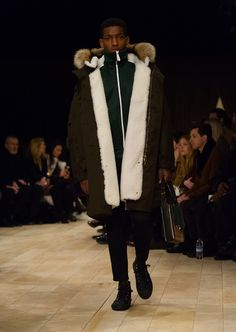 Military green cotton parka with detachable shearling liner, worn with a tracksuit jacket and The Satchel in dark green