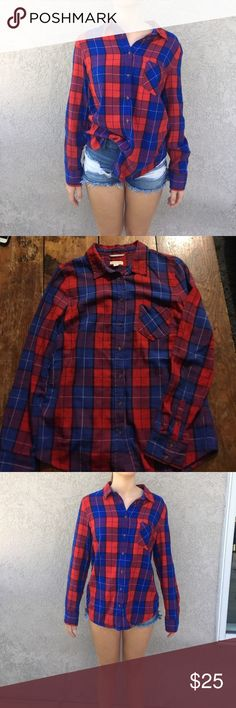 Red and Blue Checkered Long Sleeve Button Down Red and blue checkered long sleeve flannel. Model is 5'4 1/2 and usually wears size 0 or 25. Model wears small tops and is 32 A chest. Merona Tops Button Down Shirts