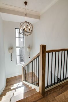 Beautiful wood staircase with chandelier and window Stair Railing Ideas beauti Beautiful chandelier Staircase stairdesign Stairs window Wood Interior Stair Railing, Wrought Iron Stair Railing, Stair Railing Design, Stair Decor, Modern Stair Railing, Stair Case Railing Ideas, Stair Risers, House Staircase, Wood Staircase