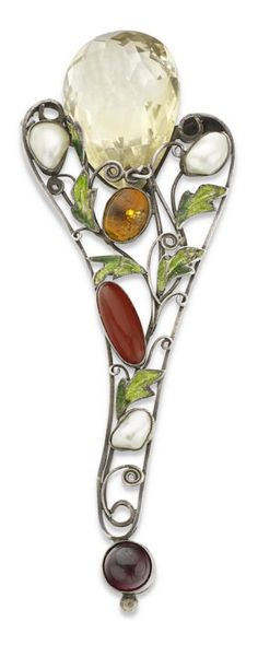 An Arts and Crafts gem-set brooch, possibly by Dorrie Nossiter or Sibyl Dunlop. The openwork brooch of stylised spray design, with blister pearls, cabochon-cut garnet, chalcedony and citrine, and green enamel leaves, all leading to a briolette-cut citrine, length 97mm. #Nossiter #Dunlop #ArtsAndCrafts #brooch