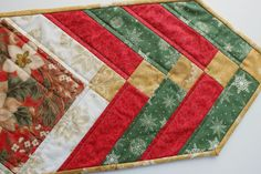Christmas French Braid patchwork quilted tablerunner. Traditional green, cream red and gold with a centre block of Christmas foilage.