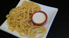 Light, Crispy & Delicious Shoestring Onion Rings with Buttermilk Dipping Sauce | She's Got Flavor