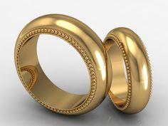 Matching 18kt gold wedding bands.