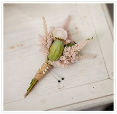 pink and green boutonniere