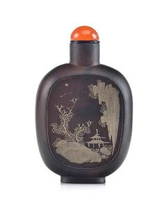 An extremely rare slip decorated Yixing snuff bottle. Qianlong mark, 1770-1795. Photo: Bonhams