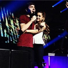 (15) Ariana Grande was Nathan Sykes's heart vacancy girl on The Wanted LA Concert on 10/18/2013 <3