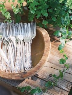 forks served in a wooden vintage bowl for a buffet