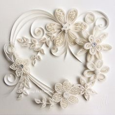 "Original Paper Quilling of ""SERENITY"" Heart shaped ivory flowers embellished with crystals & pearls."