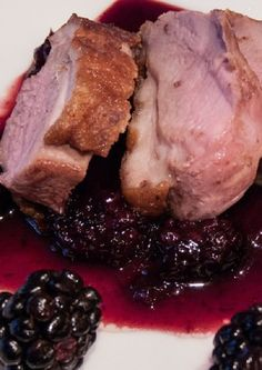 Duck breasts baked in oven and served with homemade blackberry sauce.Delicious!