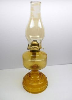 Vintage Oil Lamp Vintage Oil lamp Pressed glass lamp holds a yellow gold color! Antique Hurricane Lamps, Antique Oil Lamps, Vintage Lamps, Camping Lamp, Lantern Lamp, Lanterns, White Lamp Shade, Large Lamps, Amber Bottles