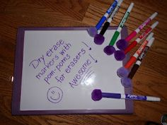 Dry erase markers with pom poms for erasers!