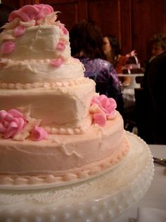 """Each table had a little wedding cake on it inspiring a """"cake crawl"""" at my bridal shower. It made a beautiful centerpiece."""