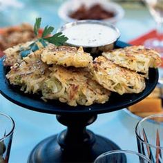 This is based on keftes de prasa, a traditional Sephardic recipe for fritters. Leeks add an aromatic note to traditional Hanukkah latkes (potato pancakes). Fritters and latkes are typically fried with olive oil; here, we use canola oil, which has a mild flavor and high smoke point to brown the fritters. To prepare fritters ahead, place cooked fritters in a 250° oven to stay warm until you're ready to serve. Garnish with parsley sprigs, if desired.