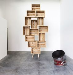 The model of the shelving units derives from traditional apple crates. They are held together by twisting and locking these especially creat...