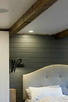 LOVE - wood beams that are DIY! also like the swing arm lamps and the tufted headboard. bluish gray wall color. DISLIKE - glossy white beadboard ceiling, headboard looks a little sloppy.