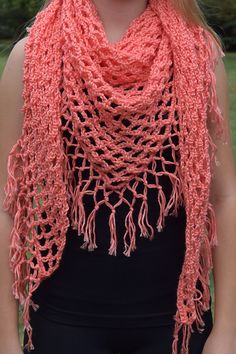 This triangular scarf is worked up with an easy mesh stitch, with a fringe border added around.