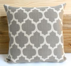 Taupe gray and tan moroccan quatrefoil decorative throw pillow cover. $28.00, via Etsy.