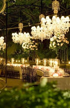 Outdoor-entertaining inspiration: Candlelight and chandeliers create an elegant ambiance for a formal affair.