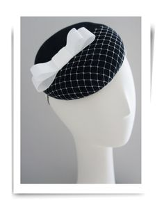 Black felt cocktail hat with white bow