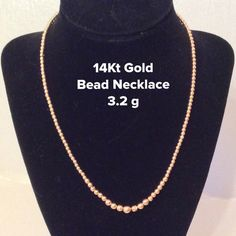 "14Kt Gold Beaded Necklace. 3.2 g Simple but Stunning. 14kt Gold (not plated) Bead necklace. Professionally cleaned, weighted and inspected by my jeweler. The beads are hollow and 2 of the beads have dents as shown in 3rd pic.  Price Reflects!!!  Weight is 3.2 g and length is 17"". Price is firm. Jewelry Necklaces"