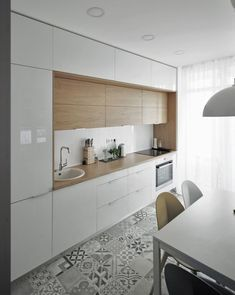 We LOVE this contemporary glass kitchen. Use our beautiful RAUVISIO crystal surfaces in your home: http://www.rehau.com/us-en/furniture/surfaces/glass/rauvisio-crystal