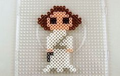 Easy to create Star Wars Perler Bead patterns. Patterns include, stormtroooper, lightsabers, Luke, Leia and so much more. A fun craft for any Star Wars fan. Pearler Bead Patterns, Bead Embroidery Patterns, Beading Patterns Free, Bead Loom Patterns, Perler Patterns, Weaving Patterns, Art Patterns, Bracelet Patterns, Kandi Patterns