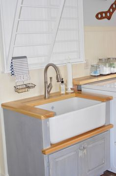 Gorgeous laundry room remodel - love the floors, sink and beadboard