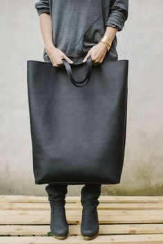 "Over-sized black leather bag :: I know a woman who shoplifts all the time to ""supplement"" her income. She dresses up (looking poor attracts unwanted attention in nice stores) and goes out with the BIGGEST purse she can find. She'd LOVE this!"