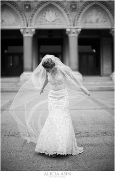 Bride playing with her veil - black and white wedding portrait