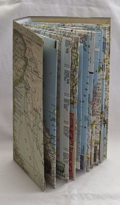 I love this both aesthetically and conceptually.Edna's Travels, by Gina Pisello 2013 Map envelopes containing travel letters from Edna from the to the Altered Books, Altered Art, Map Crafts, Map Globe, Handmade Books, Handmade Notebook, Book Themes, Book Binding, Paper Decorations