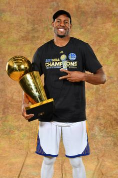 Andre Iguodala of the Golden State Warriors poses for a portrait with the Larry O'Brien Trophy after defeating the Cleveland Cavaliers in Game Five...