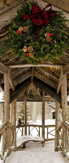 Christmas in Montana at a log home. Love this wreath & the plaid ribbon on it!
