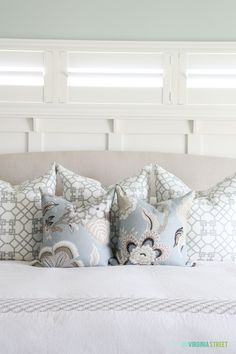 The fabric used on the euro sham is Windsor Smith's Kravet Pelagos in Mist.  The front pillows are Celerie Kemble's Schumacher Hot House Flowers in Mineral.  This is one of the easiest fabrics I have ever sewn with {I believe it is 100% linen}.