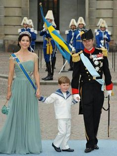Crown Prince Frederik and Crown Princess Mary with their son Prince Christian, at the wedding of Crown Princess Victoria of Sweden, where Prince Christian served as pageboy.