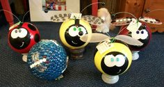 Garden bugs made from bowling balls and other repurposed materials