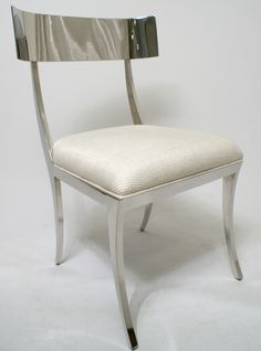 New sleek design for the modern urban dweller. Polished stainless steel frame with custom upholstered slip seat with welt. Choose from over 100 fabrics for your custom side chair. Goes elegantly with our stainless steel
