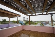 """Here, frameless solar modules produce solar energy and double as a waterproof canopy and shade on the rooftop terraces. """"The panels are laminated to glass so you can see some diffused light coming through the panels,"""""""
