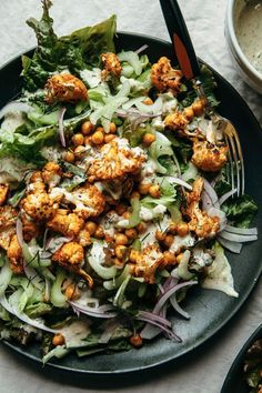Buffalo cauliflower salad with chickpeas & tahini ranch (vegan) - The First Mess